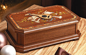 How to make a custom music box using wood inlay strips and marquetry.